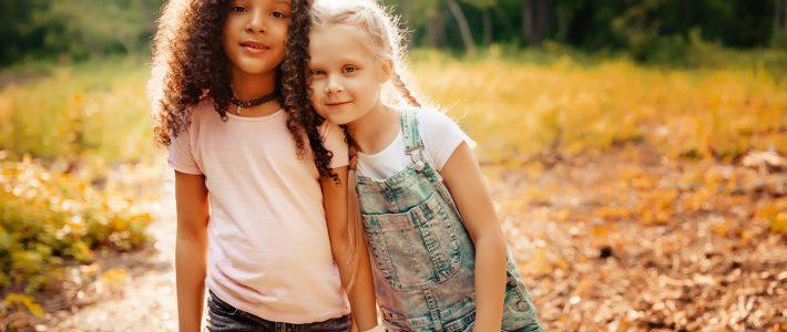 Black girl and white girl holding hands