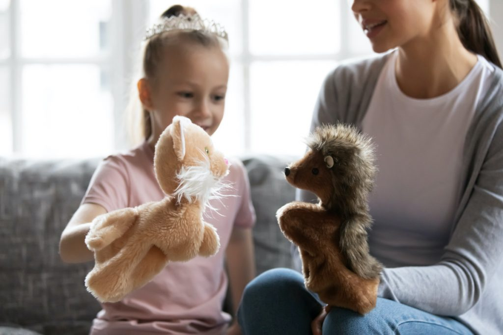 Mom and daughter playing with puppets