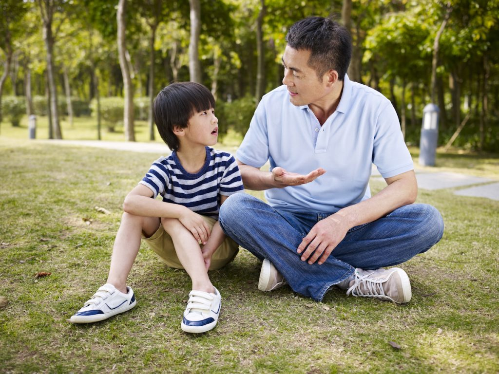 father and son having conversation