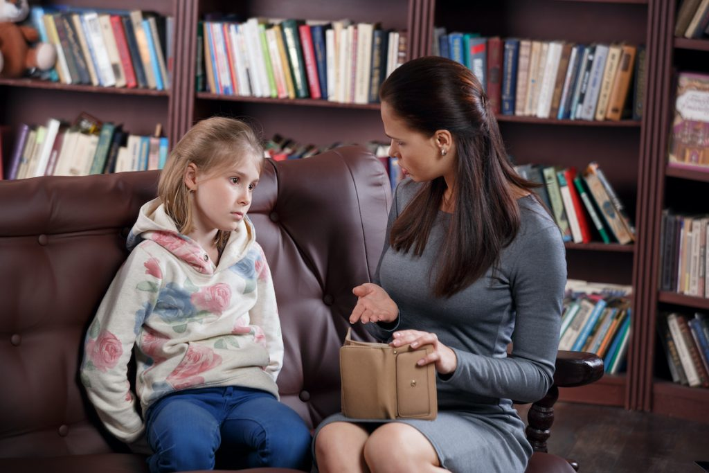 mother and daughter gently learning about right and wrong